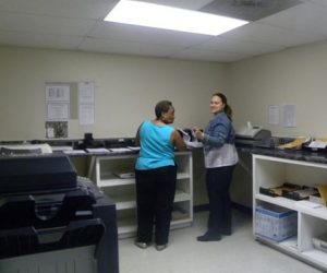 photo of medical office staff working in copy room