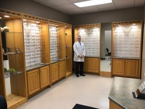 Optometrist in glasses showroom